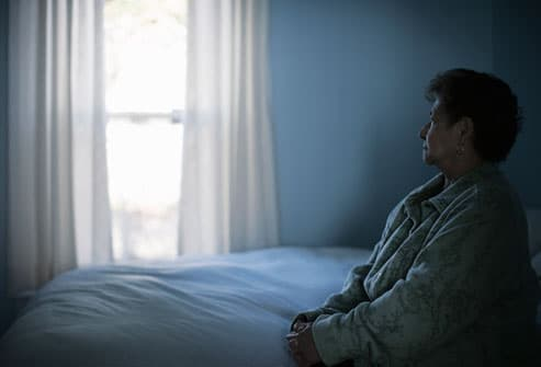 Depressed Woman Sitting on Bed