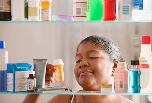Woman examining prescription bottle