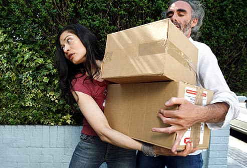 woman and man moving boxes