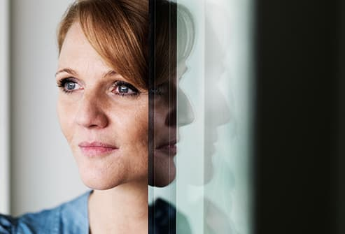 woman and reflections in glass