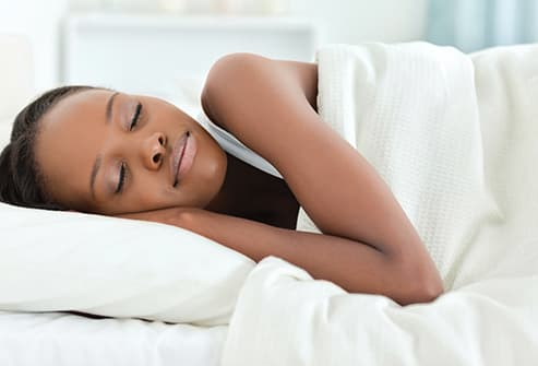 young woman sleeping on her side