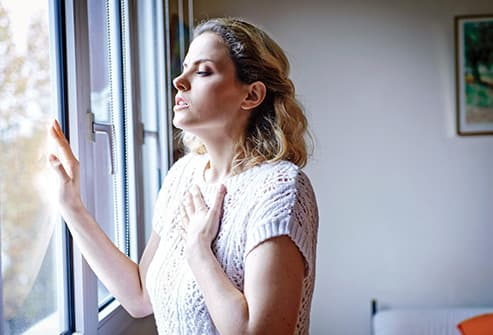 woman experiencing shortness of breath