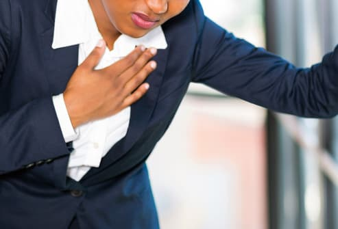 woman with chest pain close up