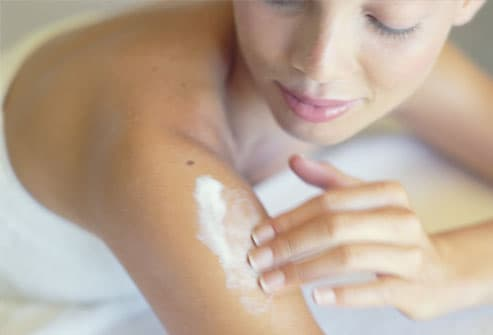 photolibary rm photo of woman applying lotion to arm Psoriasis Where I Shave