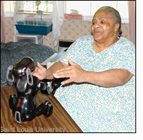 robot dog, aibo, plays with senior citizen
