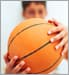 young boy holding basketball