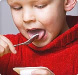 Boy eating yogurt