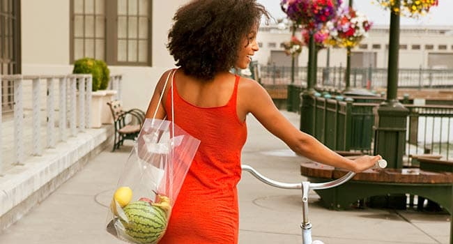 women with grocery and a bike