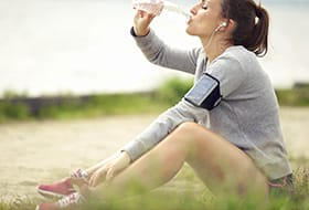 woman jogger drinking water
