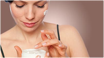 Woman Applies Face Cream for Eczema