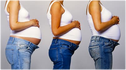 Three pregnant women standing in a row