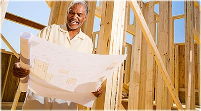 man reviewing building plans