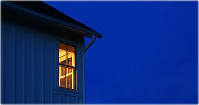lighted window in dark night