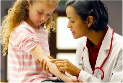 Pediatrician Examining a Girl s Rash