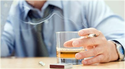 Man smoking and drinking alcohol