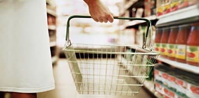 Woman holding empty shopping basket