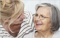 woman smiling at older woman