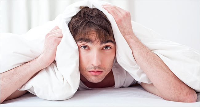 Man with pillow over head