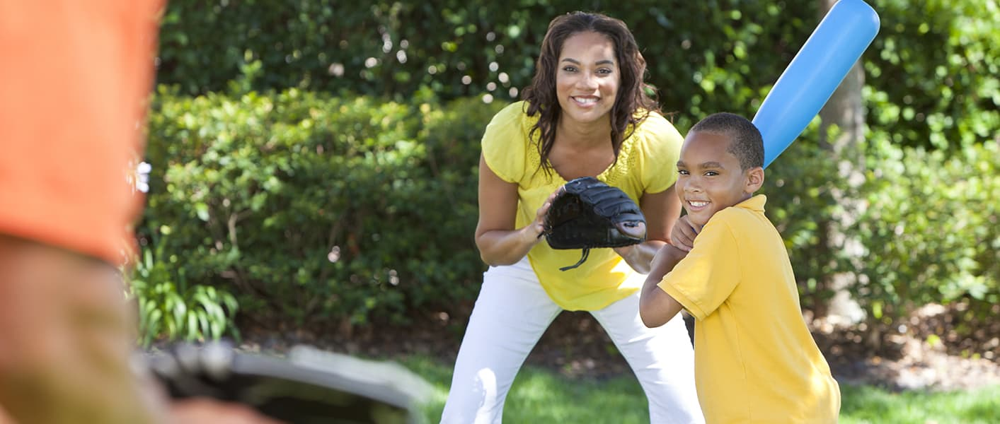 mother and son playing baseball