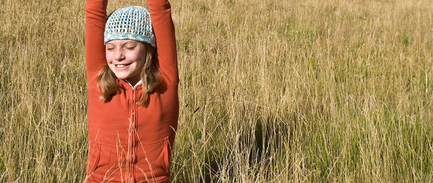 girl stretching in a field
