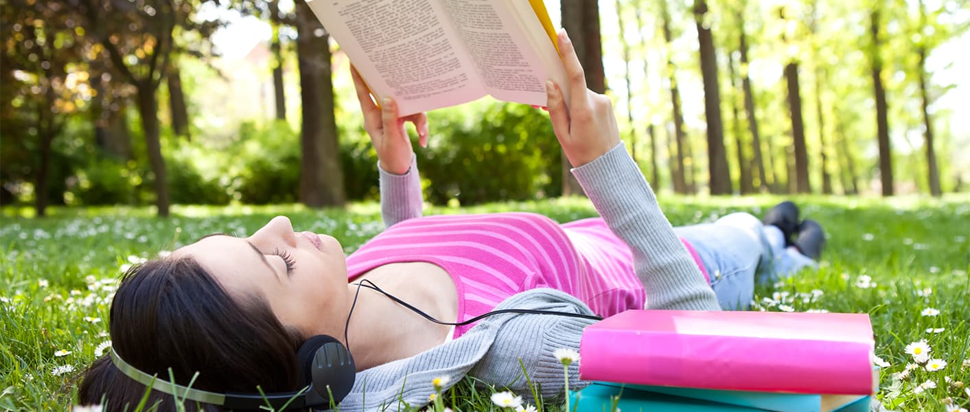 girl in park reading book