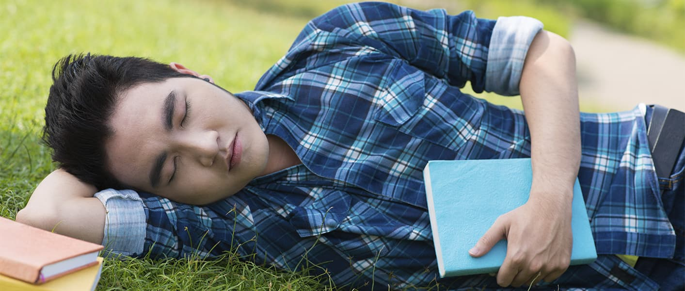 boy resting on grass