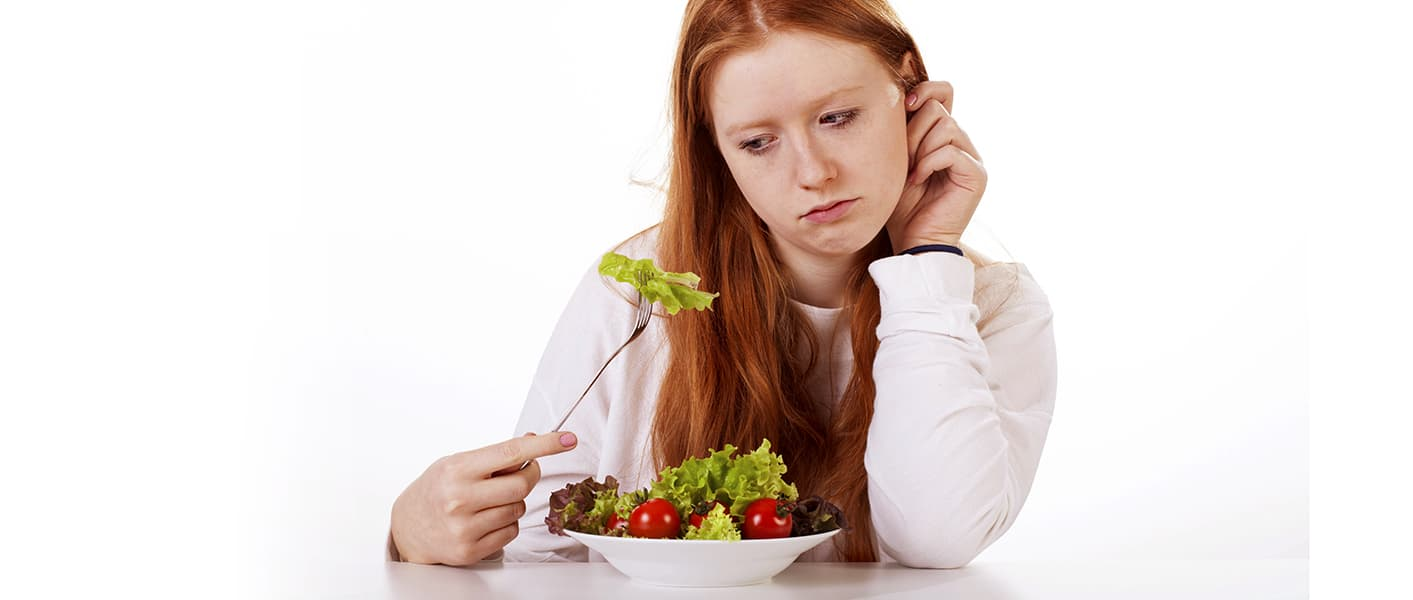 girl looking at salad