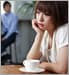 Woman staring into space with coffee