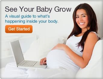 smiling pregnant woman on laptop