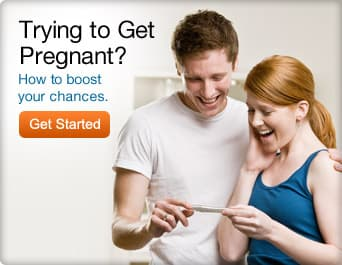 man and woman looking at pregnancy test