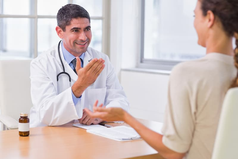 photo of doctor in discussion with patient