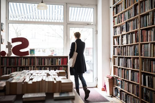 photo of woman leaving bookstore