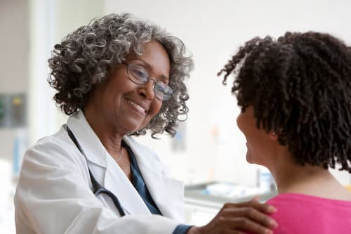 photo of doctor greeting patient