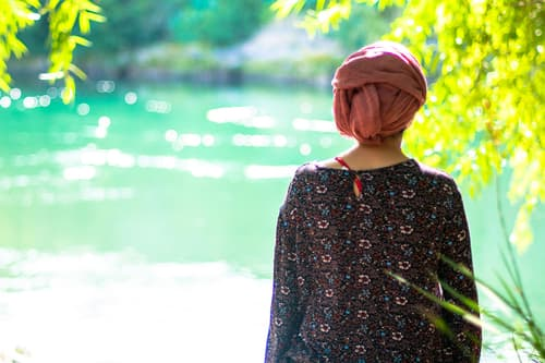 photo of woman looking at river