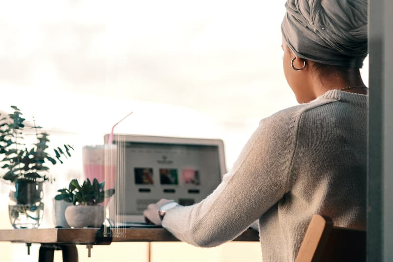 photo of woman working on laptop
