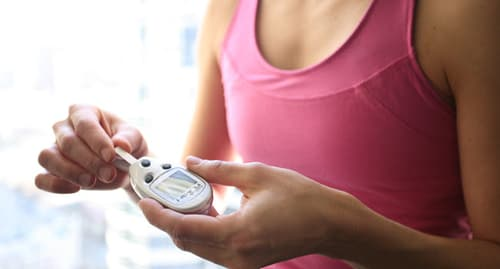 woman checking blood sugar