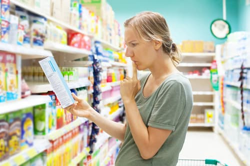 woman concerned food label