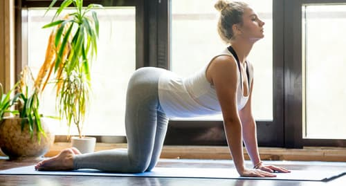 woman on exercise mat