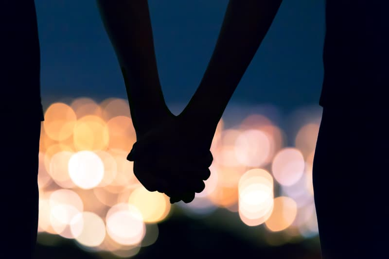 photo of couple holding hands at hight
