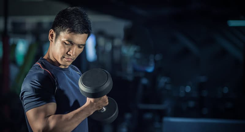 asian man lifting weight