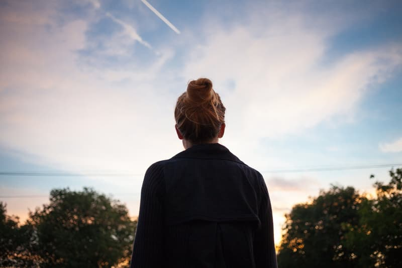 woman silhouette looking at sky