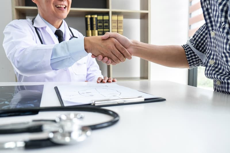 doctor and patient shaking hand