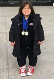 Mia D'Angelo with medals