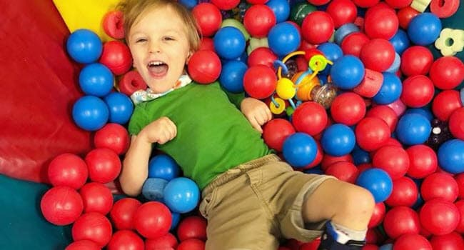 Malcolm having fun in a ball pit