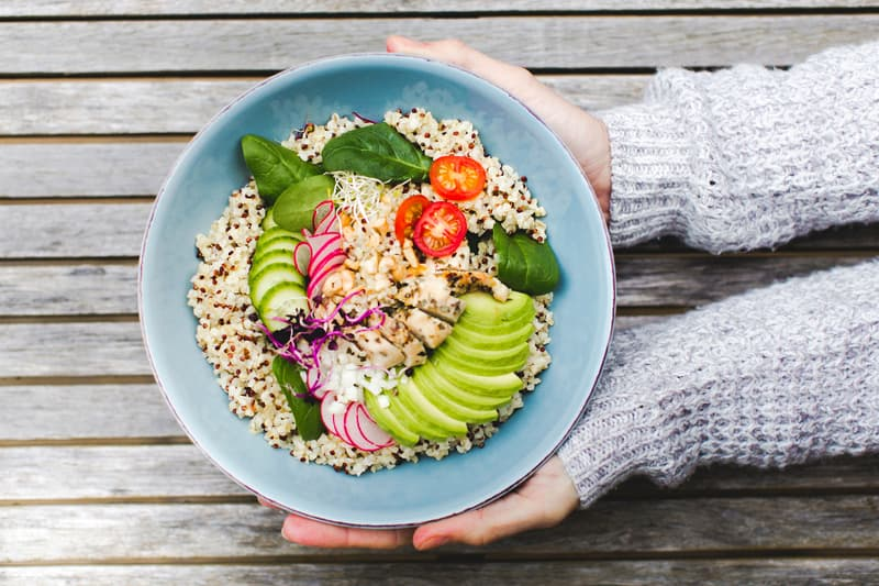 photo of cropped hands holding salad bowl