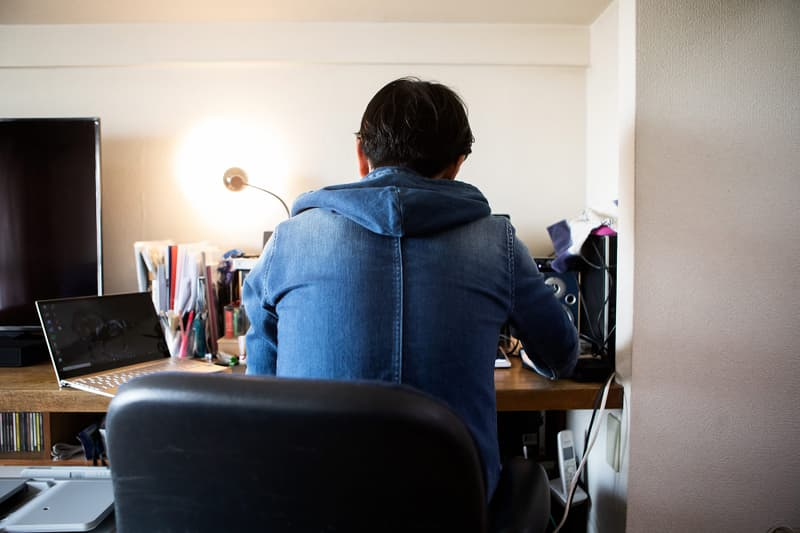 photo of man working from home