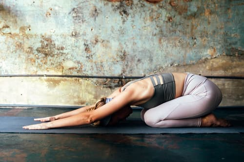 photo of woman doing yoga at home
