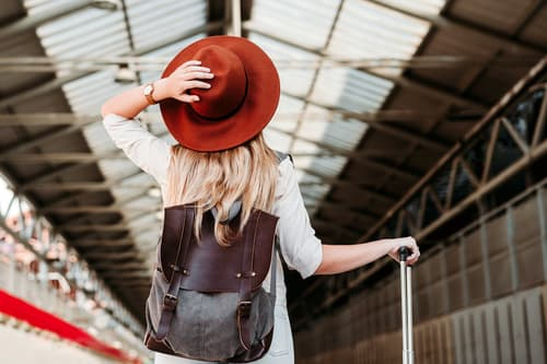 photo of woman in railroad station