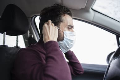 man driving mask
