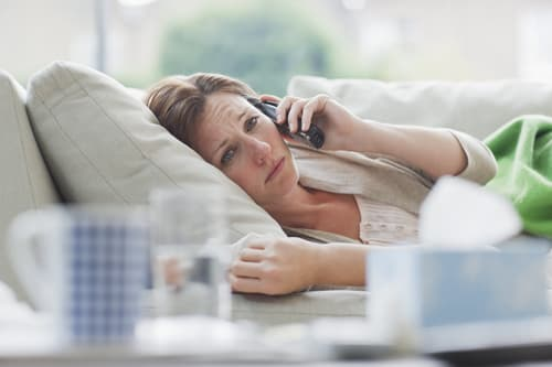 sick woman on phone